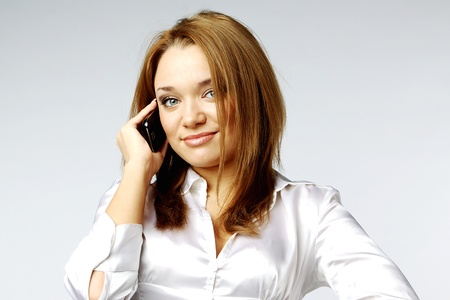 Young and beautiful girl talking on cell phone Stock Photo - 12082810