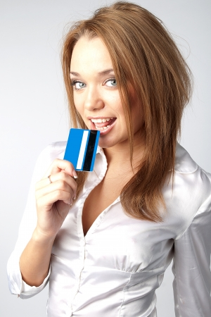 Young and beautiful girl with a credit card in the hands of blue Stock Photo - 12082838