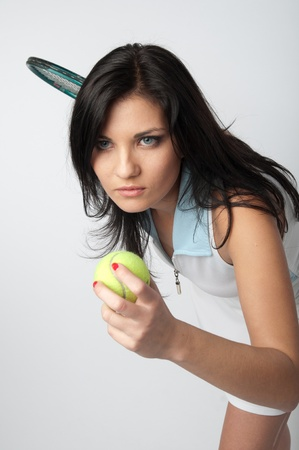 Portrait of a young and beautiful girl in tennis in the form of a racket and a ball in his hands Stock Photo - 12082886