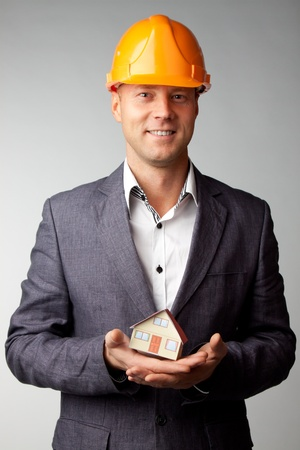 Little House on the hands of a man Stock Photo - 12082868
