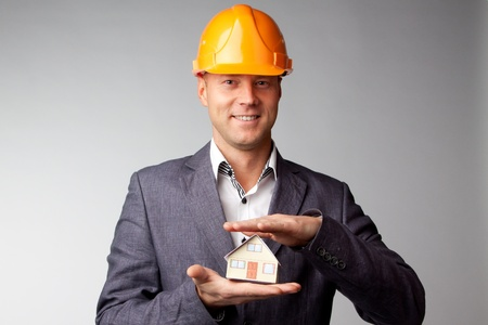 Little House on the hands of a man Stock Photo - 12082869