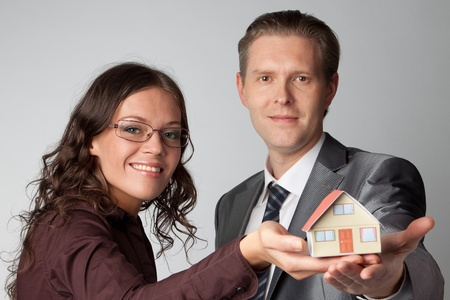 Little House on the hands of a man Stock Photo - 12082887
