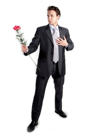 Portrait of a young successful businessman with a flower in your hand Stock Photo - 12321482
