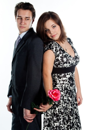 A young man gives a beautiful young woman, a flower in honor of the holiday Stock Photo - 12322556