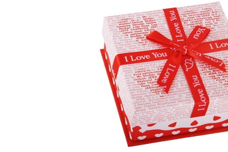 Bright red gift box on the isolated background photo