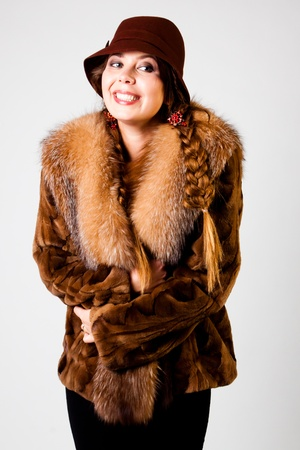 Portrait of a young and beautiful woman in a winter coat and hat Stock Photo