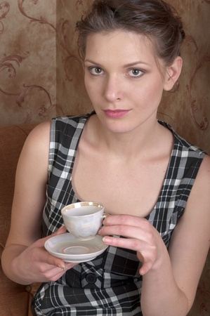 the young gerl witn cup of coffee Stock Photo - 12600269