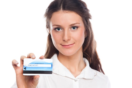 Young and beautiful girl with a credit card in the hands of blue photo