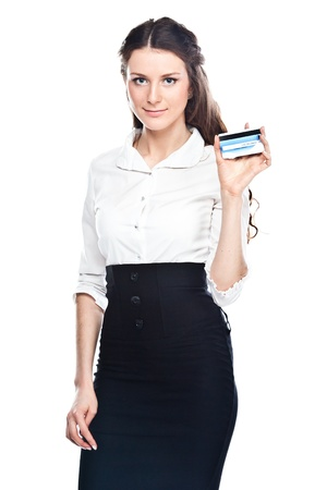 Young and beautiful girl with a credit card in the hands of blue
