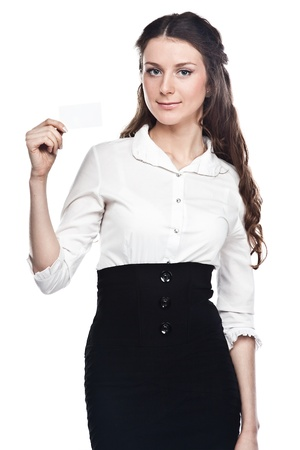 Portrait of a young and beautiful girl with a blank business card in the hands of photo