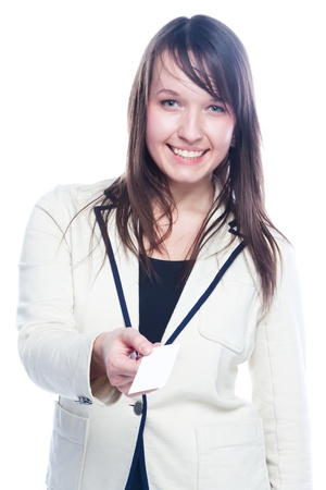 Portrait of a young and beautiful girl with a blank business card in the hands of Stock Photo - 12599129