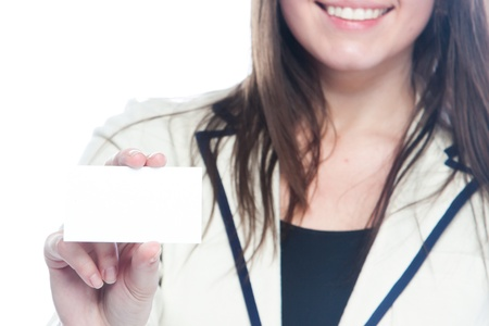 Portrait of a young and beautiful girl with a blank business card in the hands of Stock Photo - 12599166