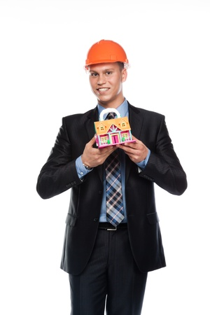 ure: young man in a helmet with the layout of a country house