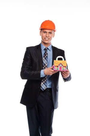young man in a helmet with the layout of a country house Stock Photo - 12599066