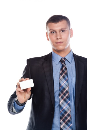 Portrait of a businessman in a business suit with a white business card in his hand Stock Photo - 12598929