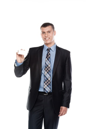 Portrait of a businessman in a business suit with a white business card in his hand Stock Photo - 12598920