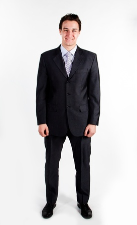 business suit: A young and successful business man in a dark business suit colors
