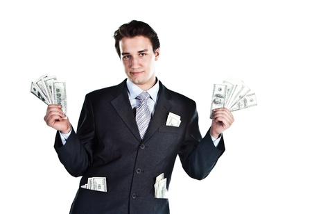 money flying: Retrato de un joven empresario con un traje oscuro rodeado de billetes de dólar que vuelan Foto de archivo