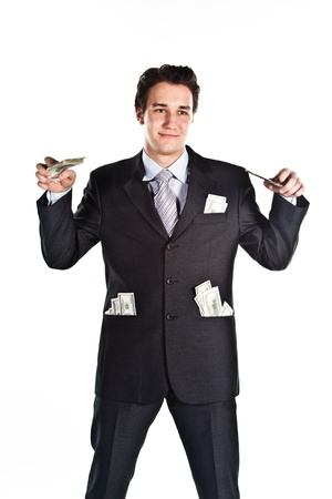 Portrait of a young businessman in a dark suit surrounded by flying dollar bills Stock Photo - 12794081