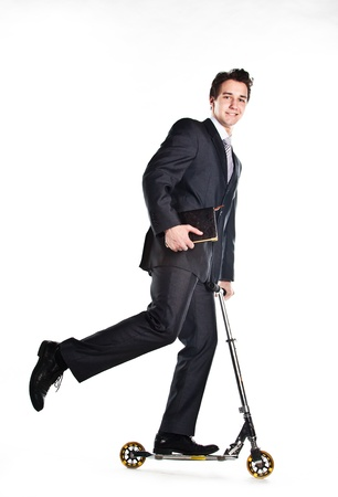 respectable: Portrait of a young respectable and successful man in a dark business suit who rides a scooter