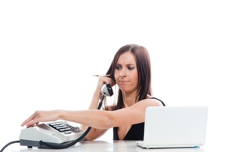 Young and beautiful girl with an old secretary of the phone and a laptop running sitting at a desk in the office Stock Photo - 12794283