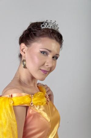 enchantress: Photo of a young and beautiful enchantress in a yellow dress
