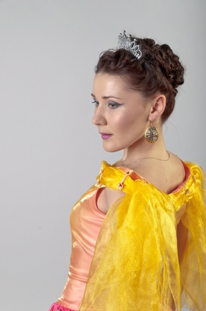 Photo of a young and beautiful enchantress in a yellow dress Stock Photo - 12794528