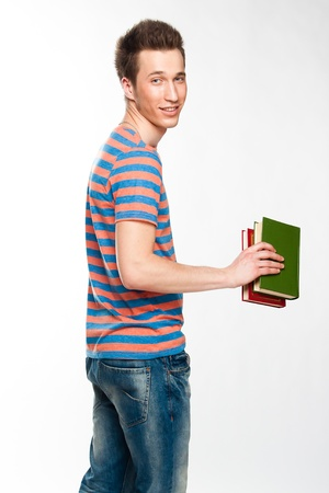 Portrait of a young attractive guy who is preparing for the exams at a university or college Stock Photo - 12893388