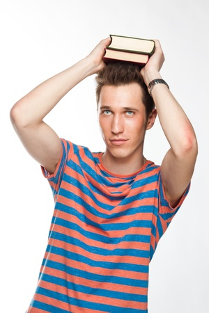 Portrait of a young attractive guy who is preparing for the exams at a university or college photo