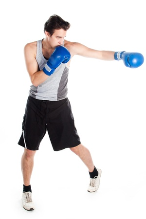 A young boxer in gray shirt and blue boxing gloves photo