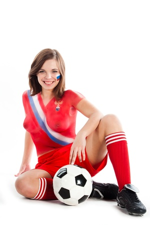 the national team:  Photo of a beautiful young girl, the upper body is painted with colors in the style of the shape of the Russian national team Stock Photo