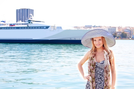 Portrait of a young and beautiful girl in the background of a large ocean liner Stock Photo - 13599063