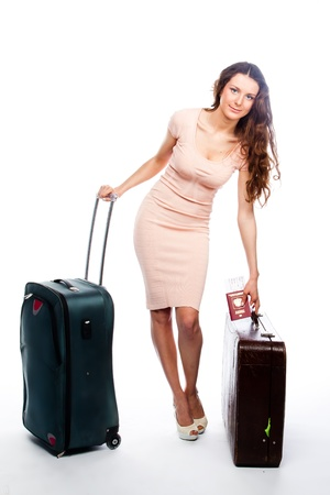 Photo of a young and beautiful girl with a suitcase, passport and ticket isolated on white background Stock Photo - 13827203