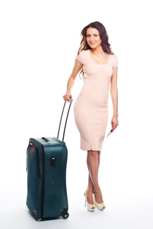 Photo of a young and beautiful girl with a suitcase, passport and ticket isolated on white background Stock Photo - 13831684