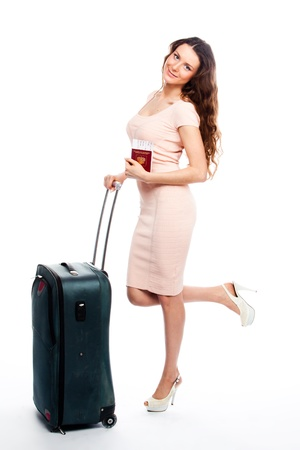 Photo of a young and beautiful girl with a suitcase, passport and ticket isolated on white background Stock Photo - 13831691