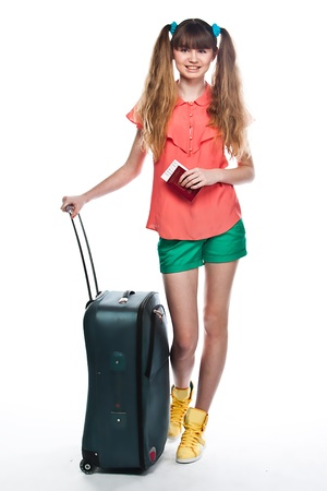 Photo of a young and beautiful girl with a suitcase, passport and ticket isolated on white background Stock Photo - 13831700