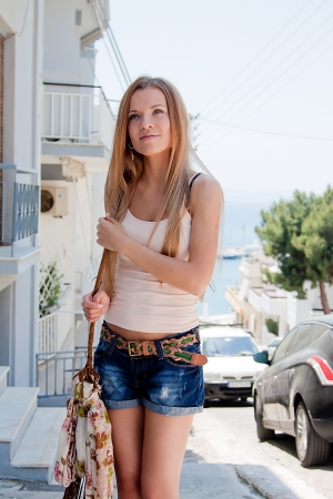 Photo of a young and beautiful girl walking down the street Stock Photo - 13851387
