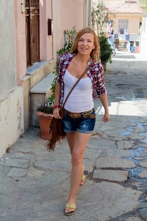 Photo of a young and beautiful girl walking down the street Stock Photo - 14024641