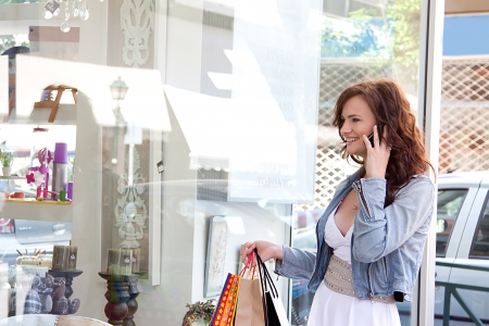 Photo of a young and beautiful woman who makes a purchase photo