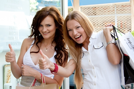 Photo of two young and beautiful women who go shopping Stock Photo - 14024559