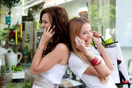 go shopping: Photo of two young and beautiful women who go shopping Stock Photo