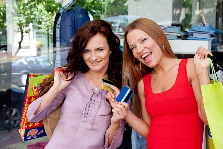 Photo of two young and beautiful women who go shopping photo