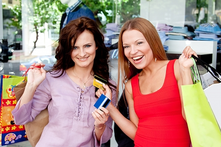 Photo of two young and beautiful women who go shopping Stock Photo - 14024634