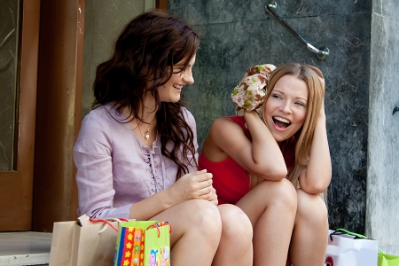 Photo of two young and beautiful women who go shopping Stock Photo - 14024675