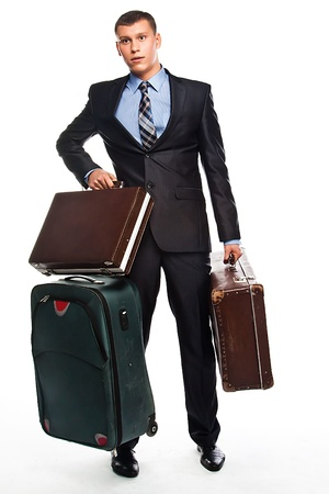 Young successful businessman in a business suit with three suitcases and a journey photo
