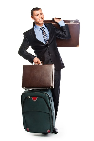 Young successful businessman in a business suit with three suitcases and a journey Stock Photo