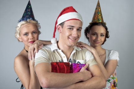 hat new year s eve: The company of young, beautiful and successful people preparing to celebrate Christmas Stock Photo