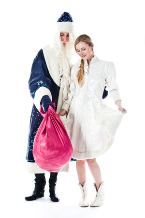 santa s bag: Santa Claus with her granddaughter prepare to greet the new year