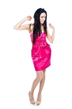 cocktaildress: Jonge en mooie vrouw in een rode cocktail jurk