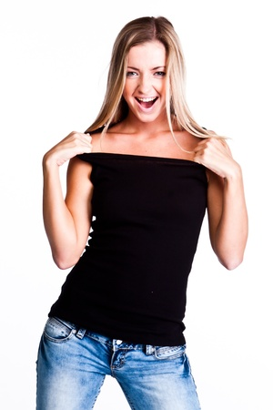 Young, beautiful and happy woman in a black shirt and blue jeans photo